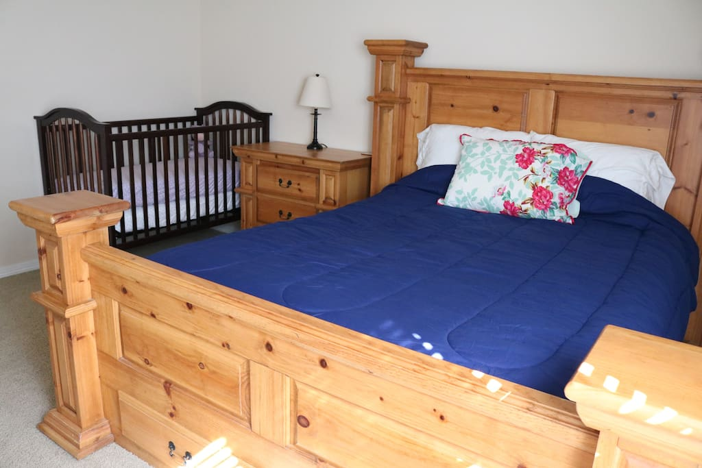 Queen bed, dresser/nightstand, and crib... in case you have a little one joining you!