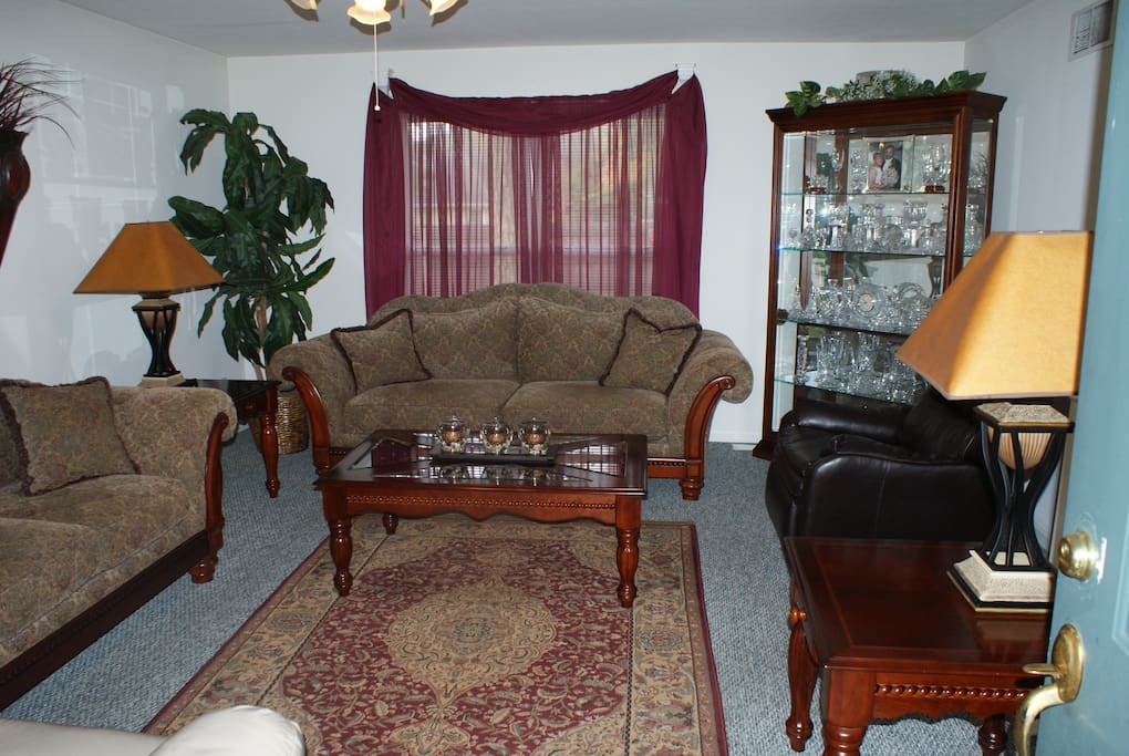 Spacious Living room with full Couch, Love seat with Air Mattress available. Sleeps 2