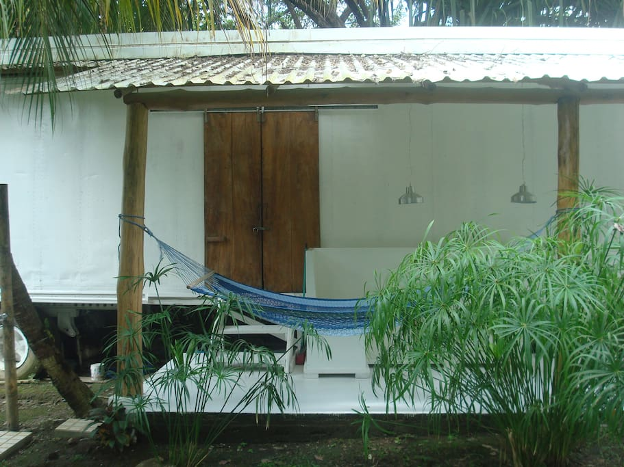 reclaimes wood doors, hammock to chill, and outdoor shower.