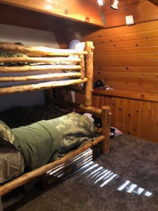 main floor bedroom bunk beds with twin over a full. can sleep 3 in this room 2 on full 1 on twin