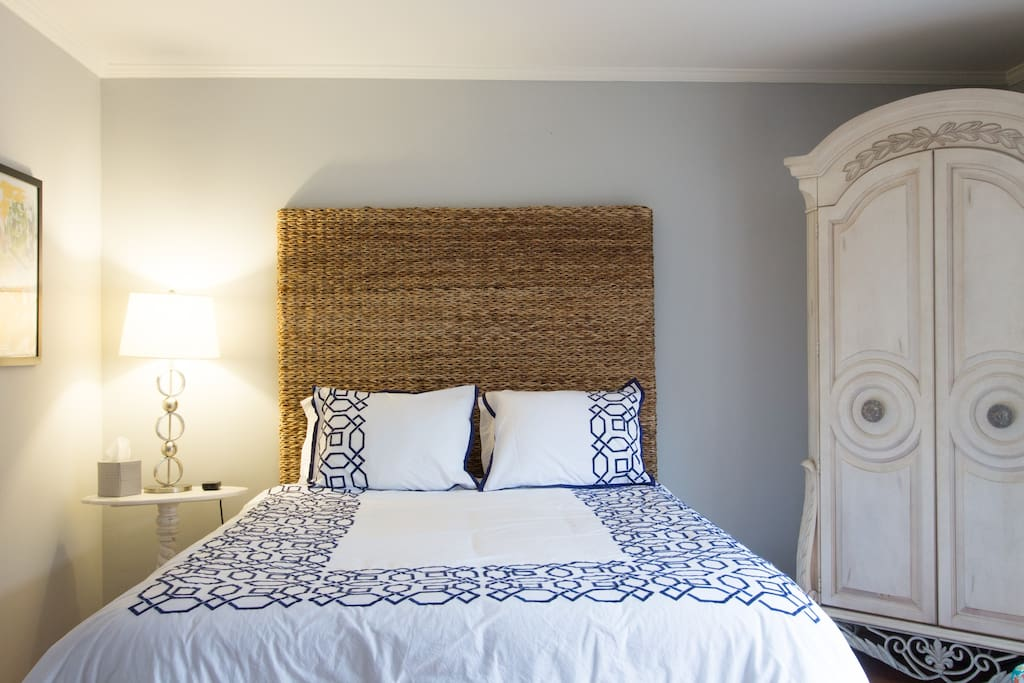 Queen-sized bed with beautiful, bedding, just like a high-end hotel room.