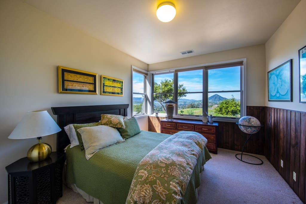 Queen Bedroom with comfy bedding and great views