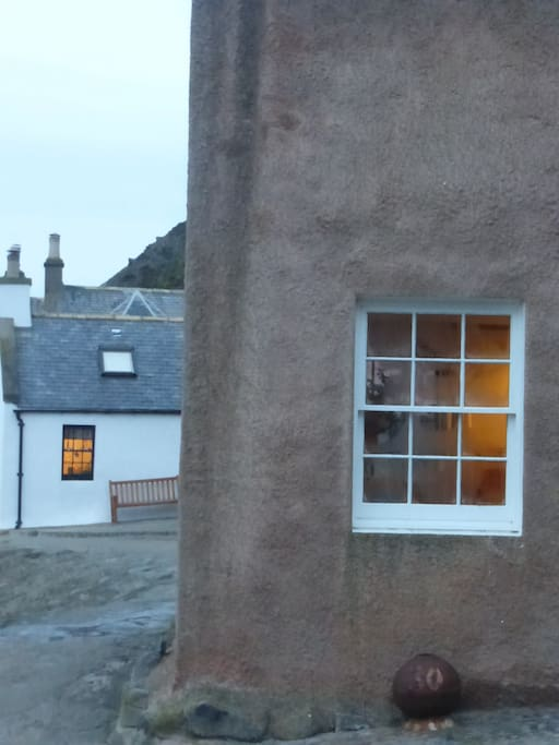 The white cottage beyond the one in the foreground