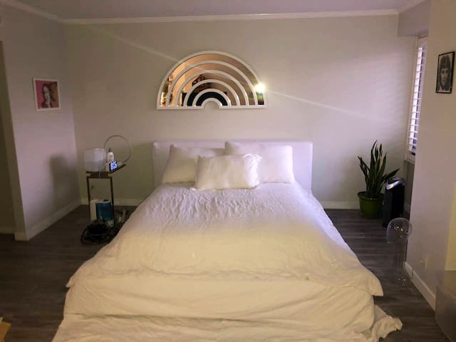 Luxurious Restoration Hardware Cloud Bed with a rainbow