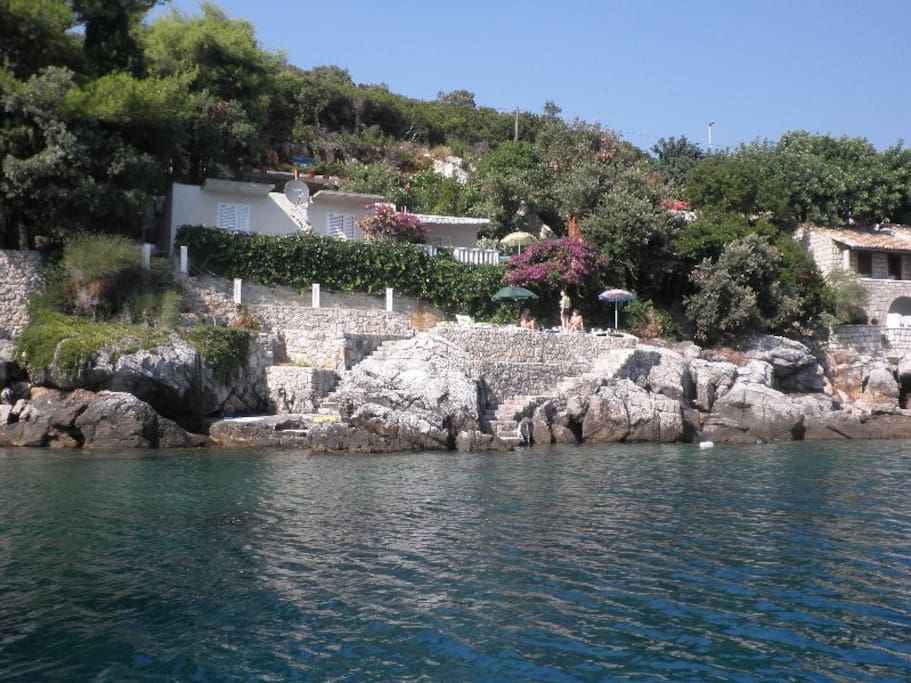 House seen from the sea with private beach