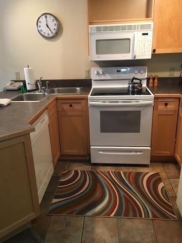 Full kitchen with range/oven, microwave, toaster, dishwasher and dining area