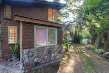 Behind the Gingerbread house is a wonderful exploration, seasonal stream and fruit trees, forest, and an organic farm.