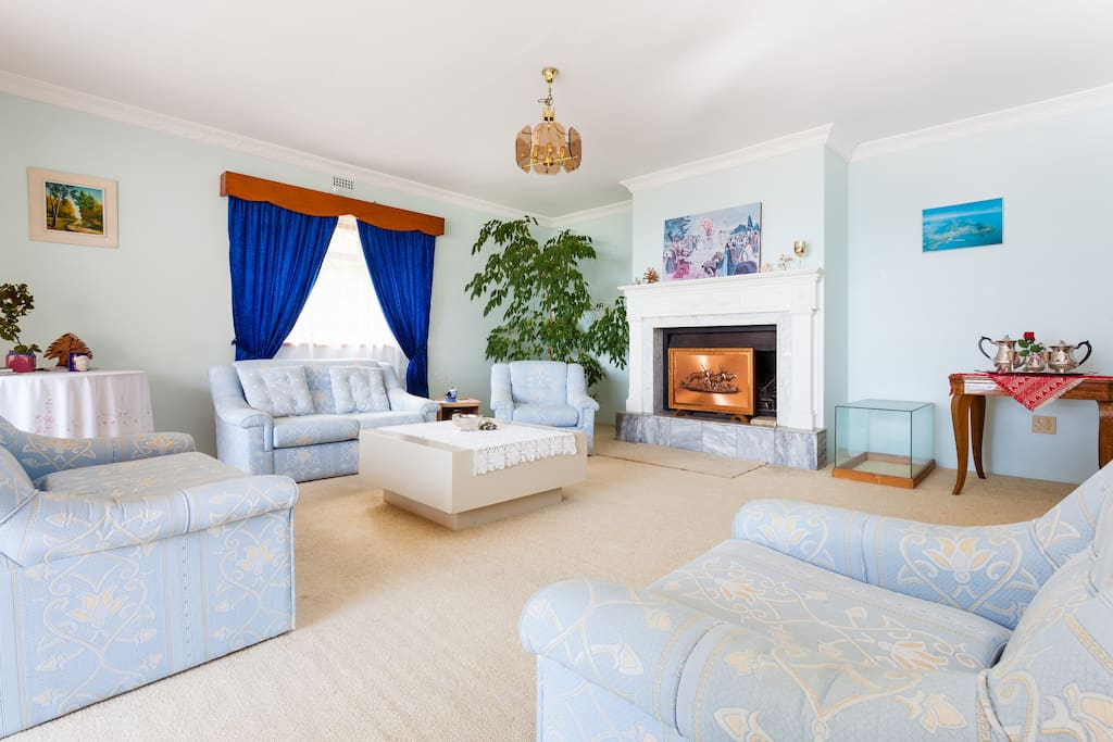 Living room with Marble Fireplace. PLEASE NOTE: A LCD TV with satellite channels has been added since the photo was taken.
