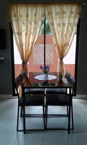 Dining/Front Area with serene private patio view......