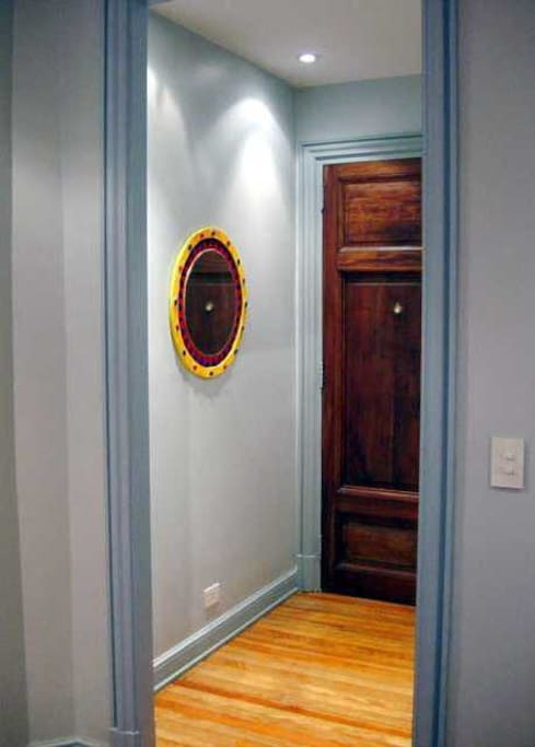Front hardwood door and entry hall at night
