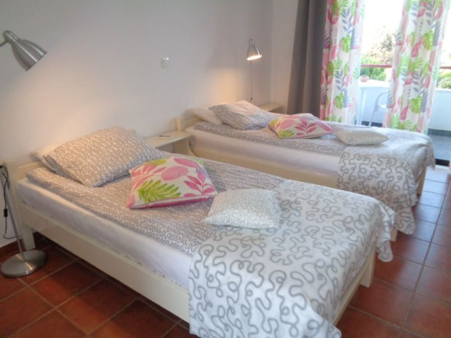 The studio is equipped with two single beds
