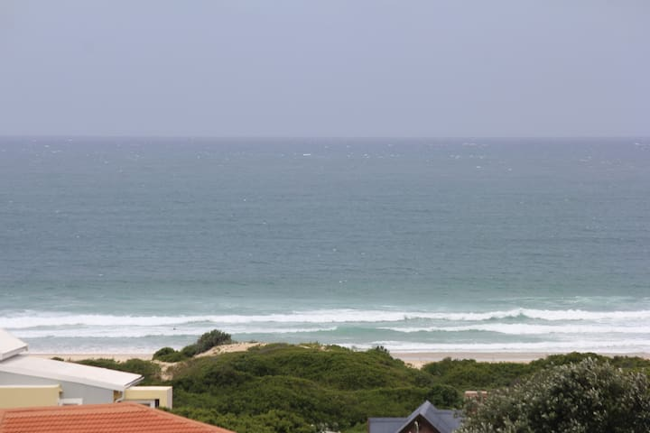 Balcony 2 view: 200m from a swimming, surfing and fishing spot or just take a leisurely walk on the pristine beach.