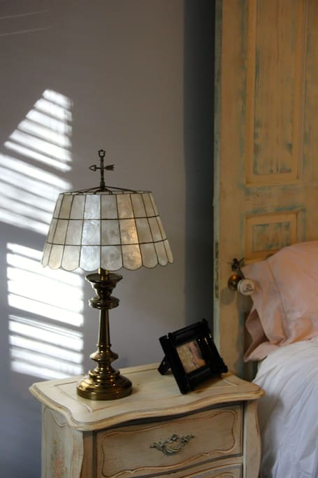 A vintage lamp lights the way at night.