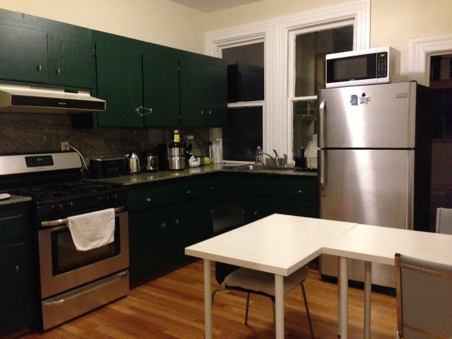 The kitchen has an oven, stove, juicer, toaster, blender, pots, pans, and all other utensils you might need.