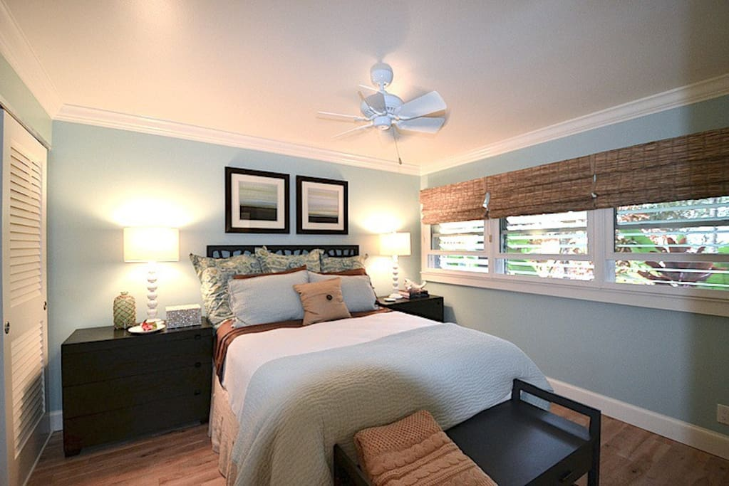 Gorgeous bedroom with pillow-top queen mattress and air-conditioner.
