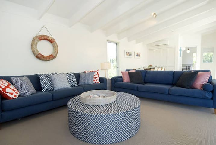 Quality furniture chosen by an interior designer for coastal chic. Large-scale relaxation zones