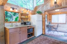 Kitchenette has granite counter, microwave, coffee maker counter-top burners and toasher oven,....BBQ outside!