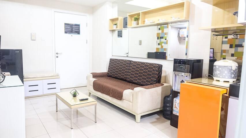 Comfortable sofa + refrigerator+ rice cooker, and beautiful furnitures.