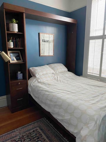 Blue bedroom: memory foam queen bed + office space for working from home