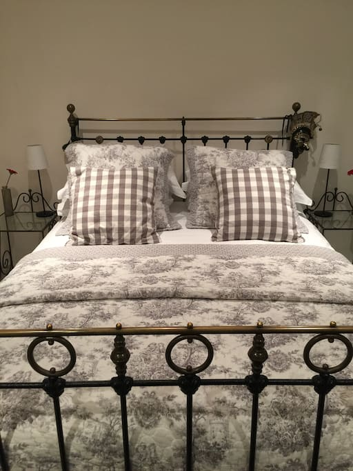 The lovely king sized bed in the master bedroom which benefits from a modern and luxurious ensuite.