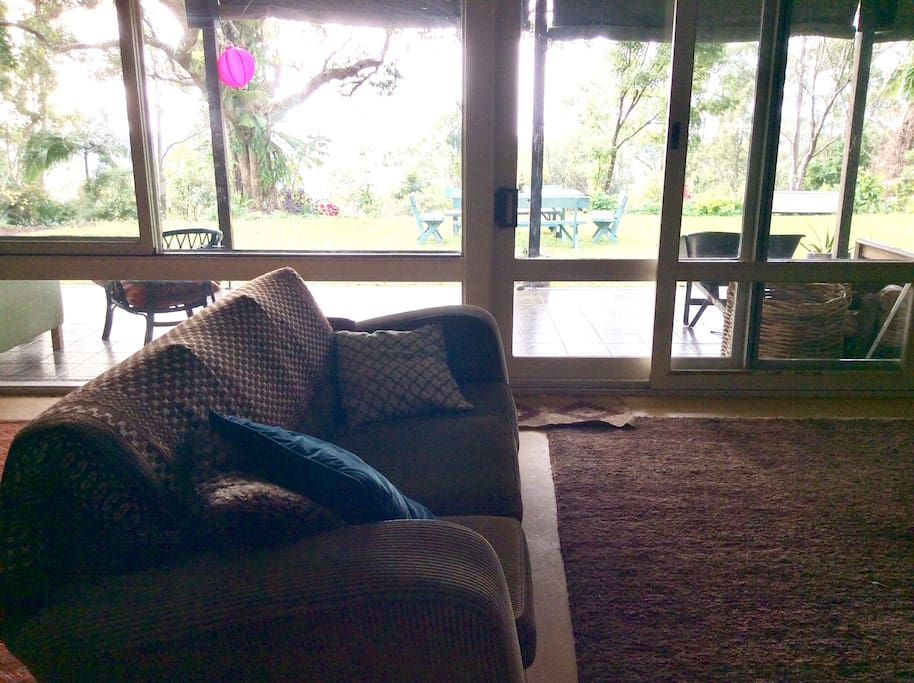 Spacious comfy lounge room opens to covered verandah, big garden and ocean and forest views