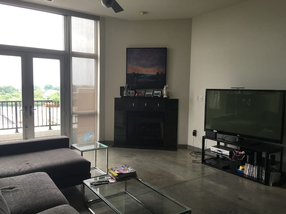 Spacious living room - equipped with 60 inch TV and access to patio facing West 25th.