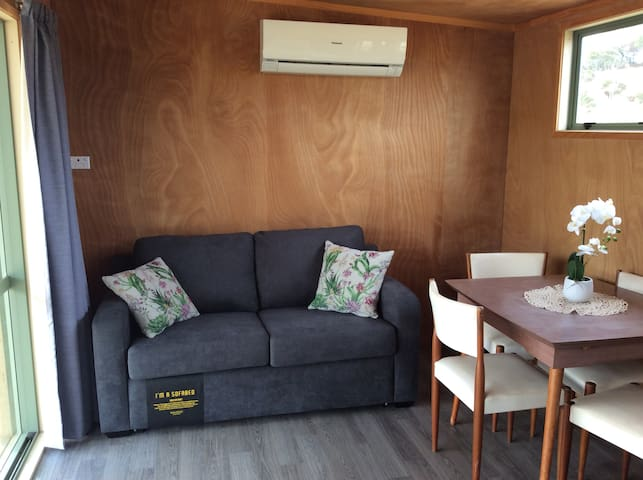 Living room - includes Air conditioning for your comfort, and a pull out double size sofa bed.