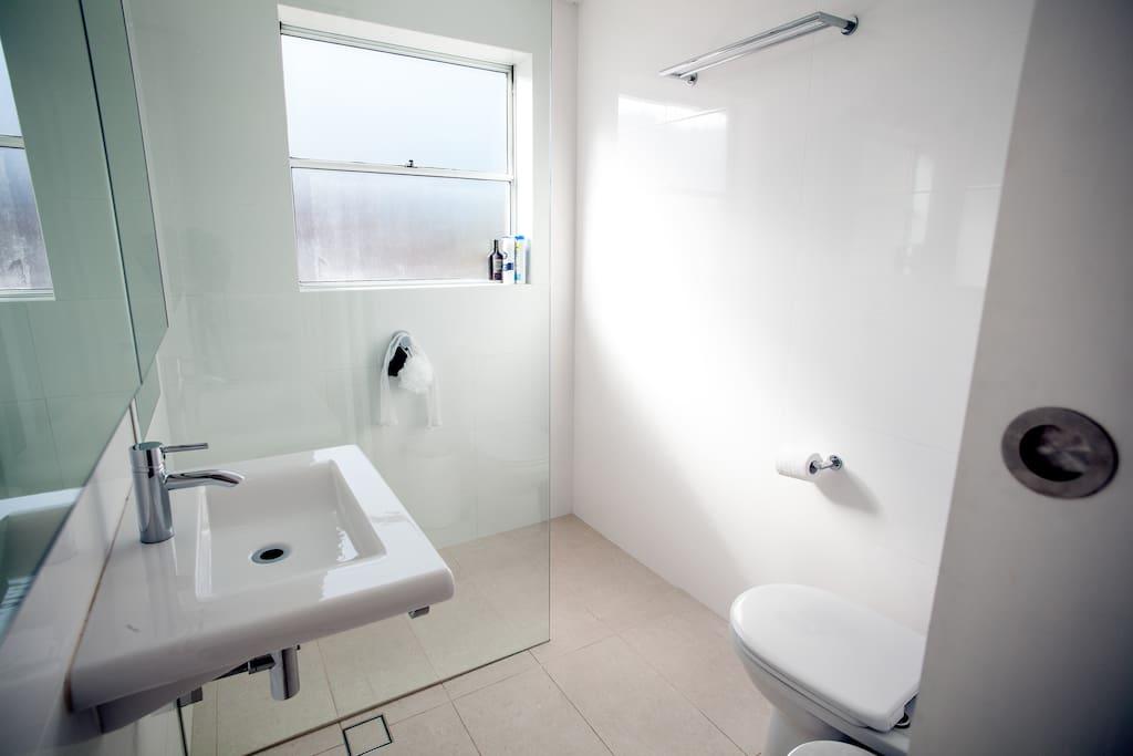 Bathroom has heated full length mirror.