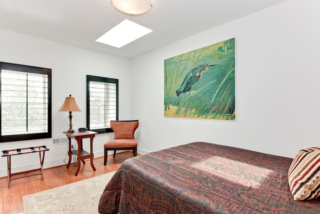 Your 3rd floor guest suite with two big, south facing windows and two skylights!