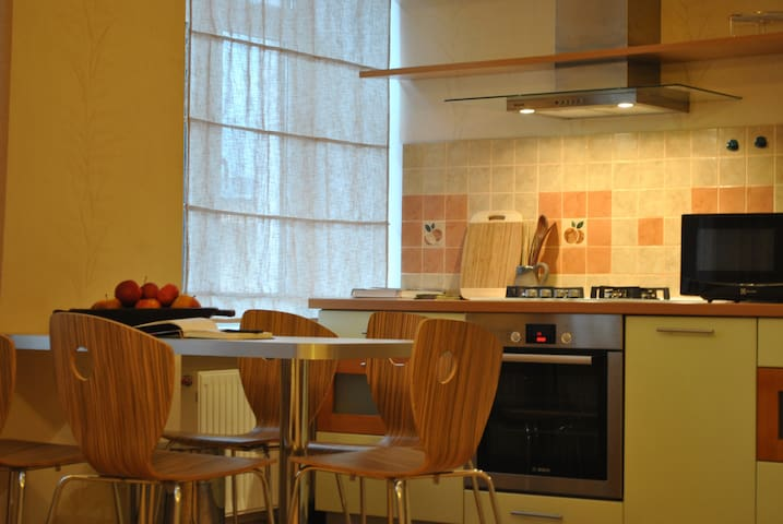 Kitchen includes all expected facilities and design dining table.