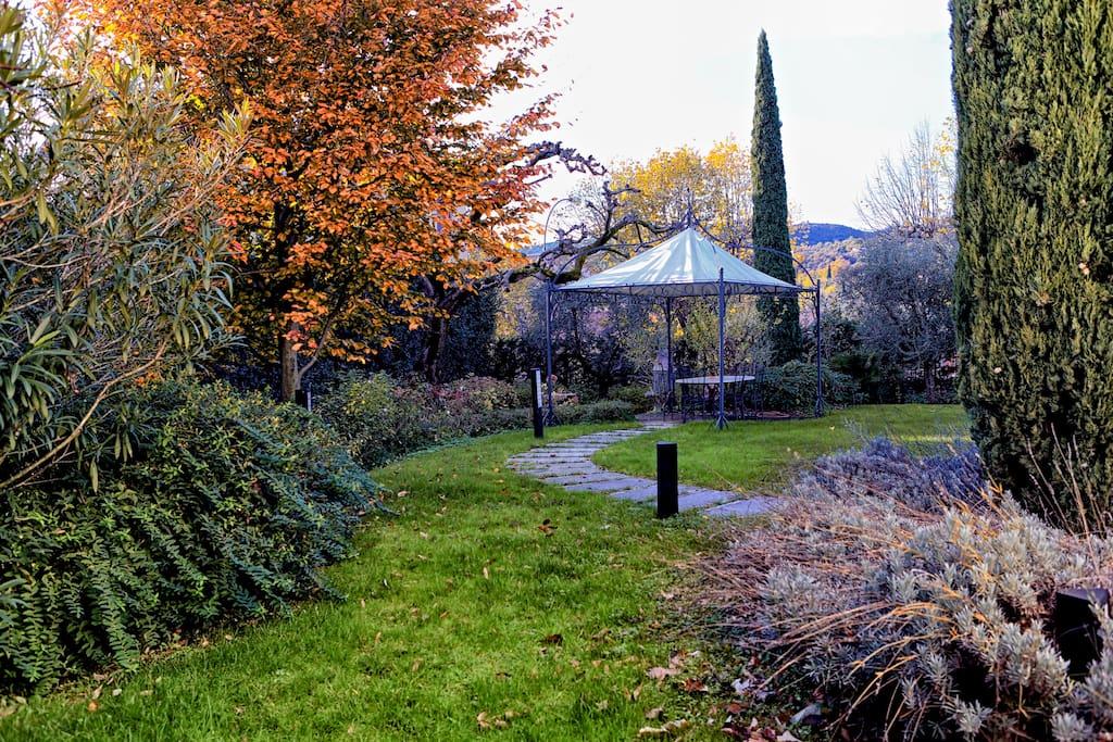 Spacious garden with gazebo in the back
