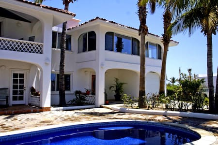 Beautiful 4bdr/3.5bath 2 story house in a gated community in San Jose Del Cabo. Ocean view. Swimming pool with outdoor barbecue area. Close to all surf and golf spots. 5 min walk to the beach. Short drive to historic downtown with access to grocery stores, No hurricane damage.