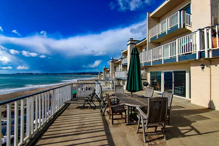 Panoramic Ocean Views Located Above the Sand!