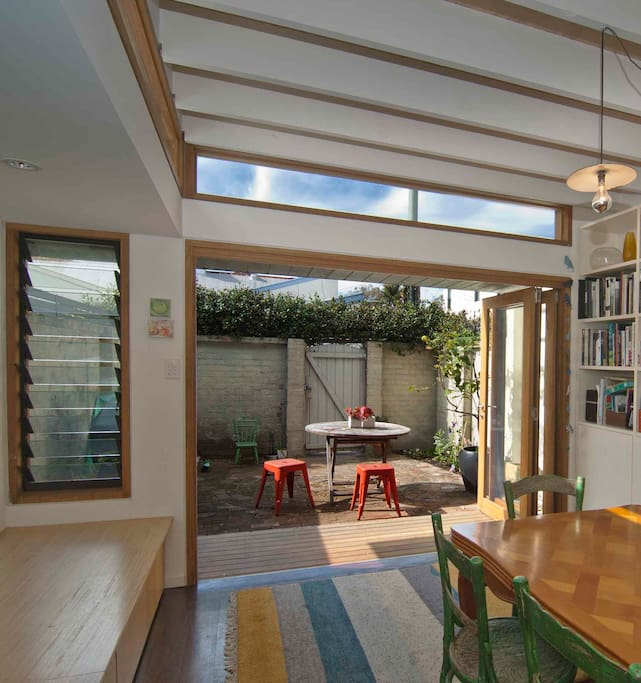 bi-fold doors open from dining room to sunny courtyard