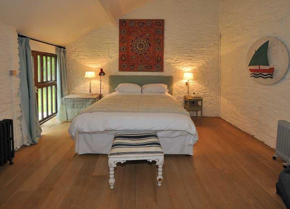Bedroom 1 with doors to the garden