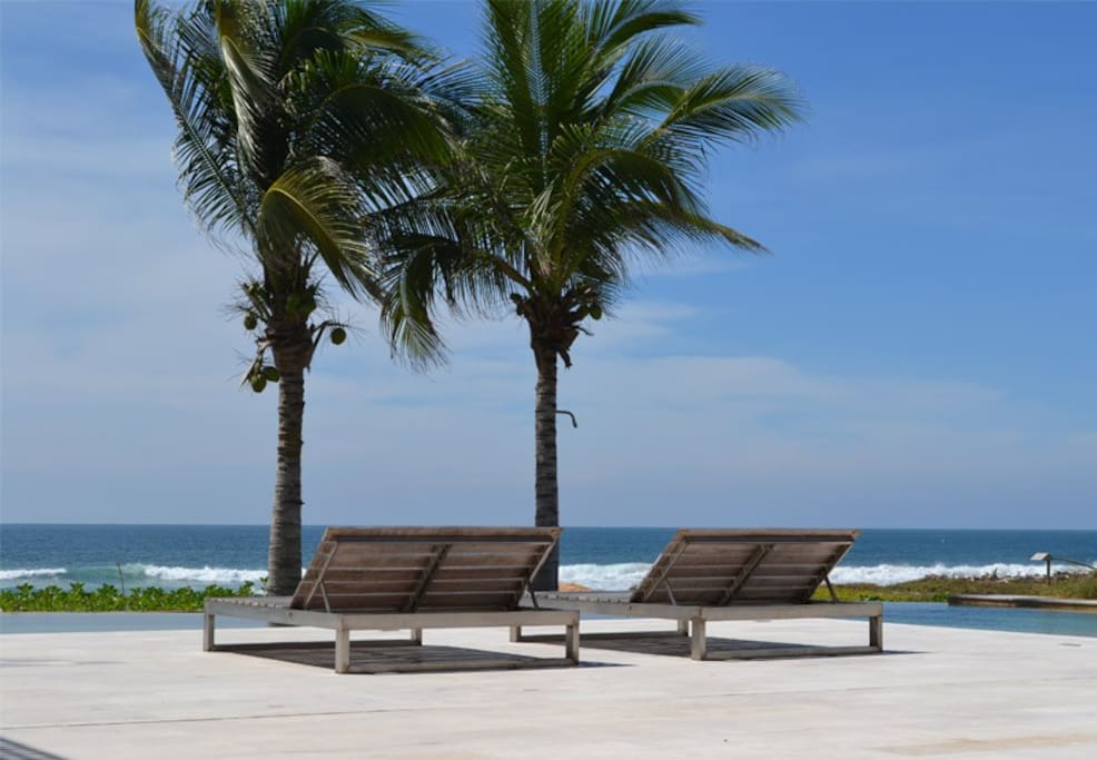 Extra roomy lounge chairs for sunbathing or reading (napping) in the shade