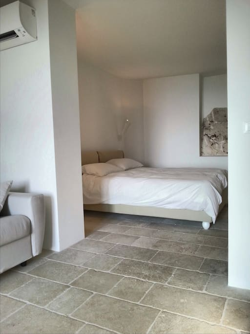 Studio apartment: the main room is open in the bedroom