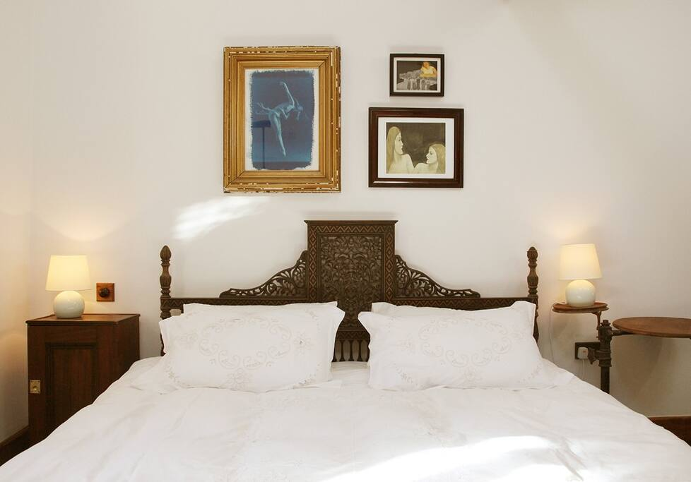 Cosy super kingsize bed with original artworks.