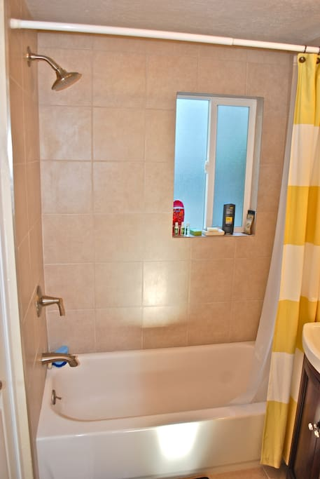 Remodeled bathroom with large shower and high-pressure shower head!