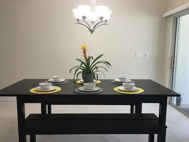 Wonderful family style dining table and spacious patio.