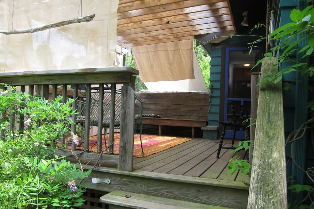 The backyard deck, with sliding curtains for shade when you want it and sun when you don't.