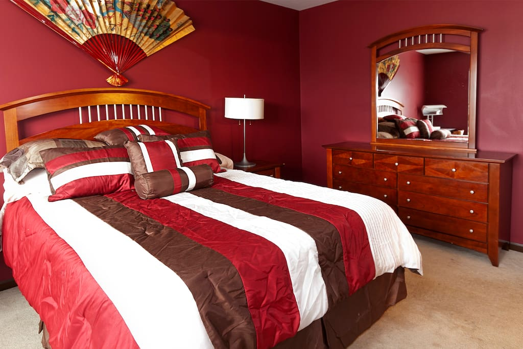 MASTER BEDROOM: Burgundy Room--Super comfortable tempurpedic mattress and lots of pillows.