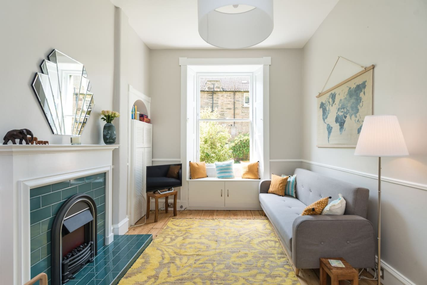 Our bright and sunny lounge overlooks the quiet, shared back garden.