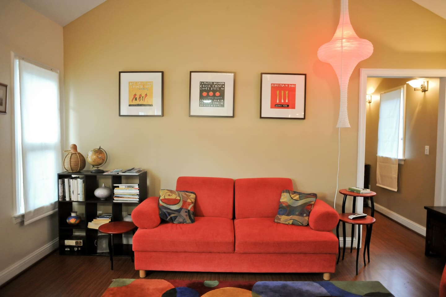 The modern and brightly lit living room with comfortable couch