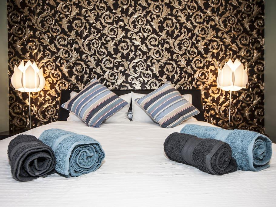 Extra length queen size bed in main bedroom