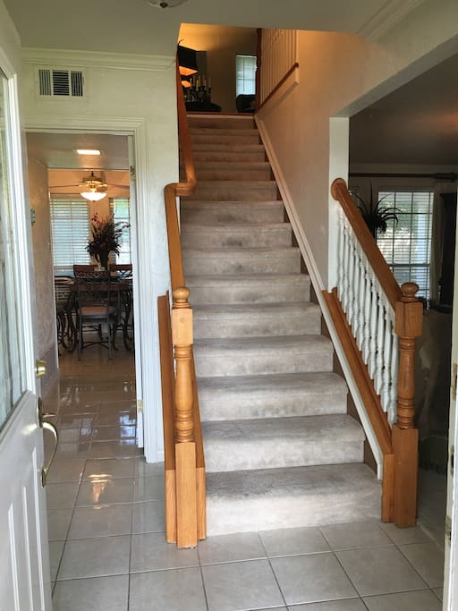Stairwell from entry-way leading to upstairs den and bedrooms