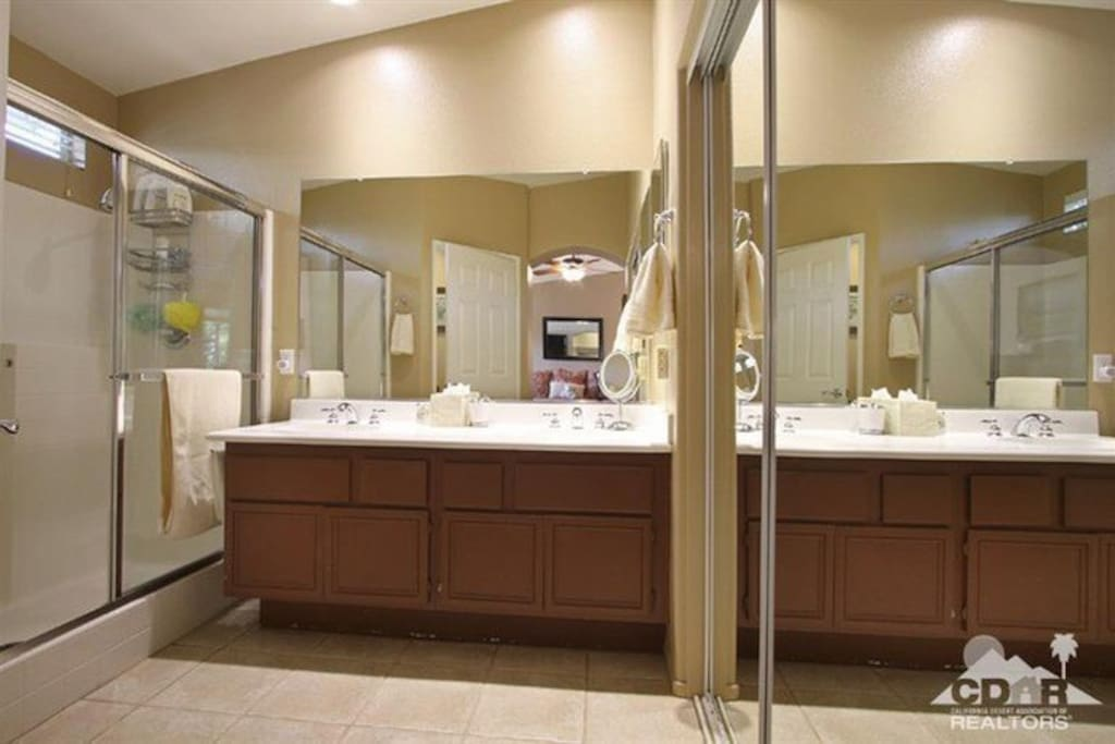 Master bath with private toilet room.