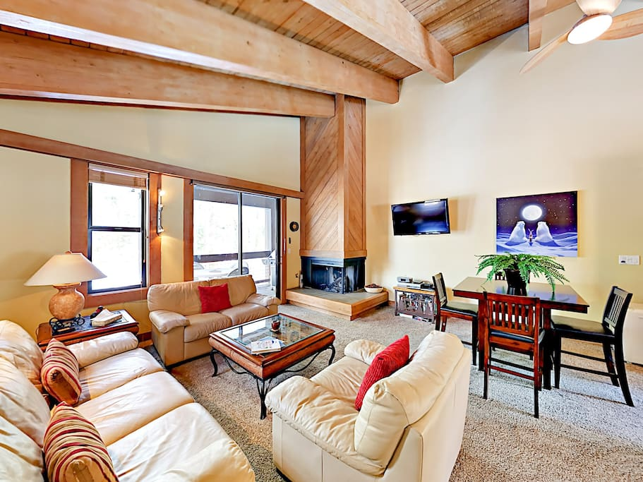 Tall ceilings and comfy seating feature in the living area.