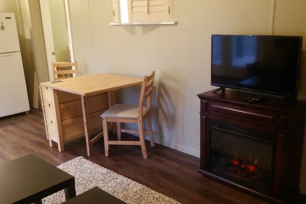 Dining space next to fireplace in Living Room