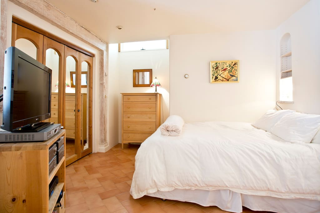 The bedroom has lots of light and a brand new very comfortable bed, lovely linens and cable t.v.
